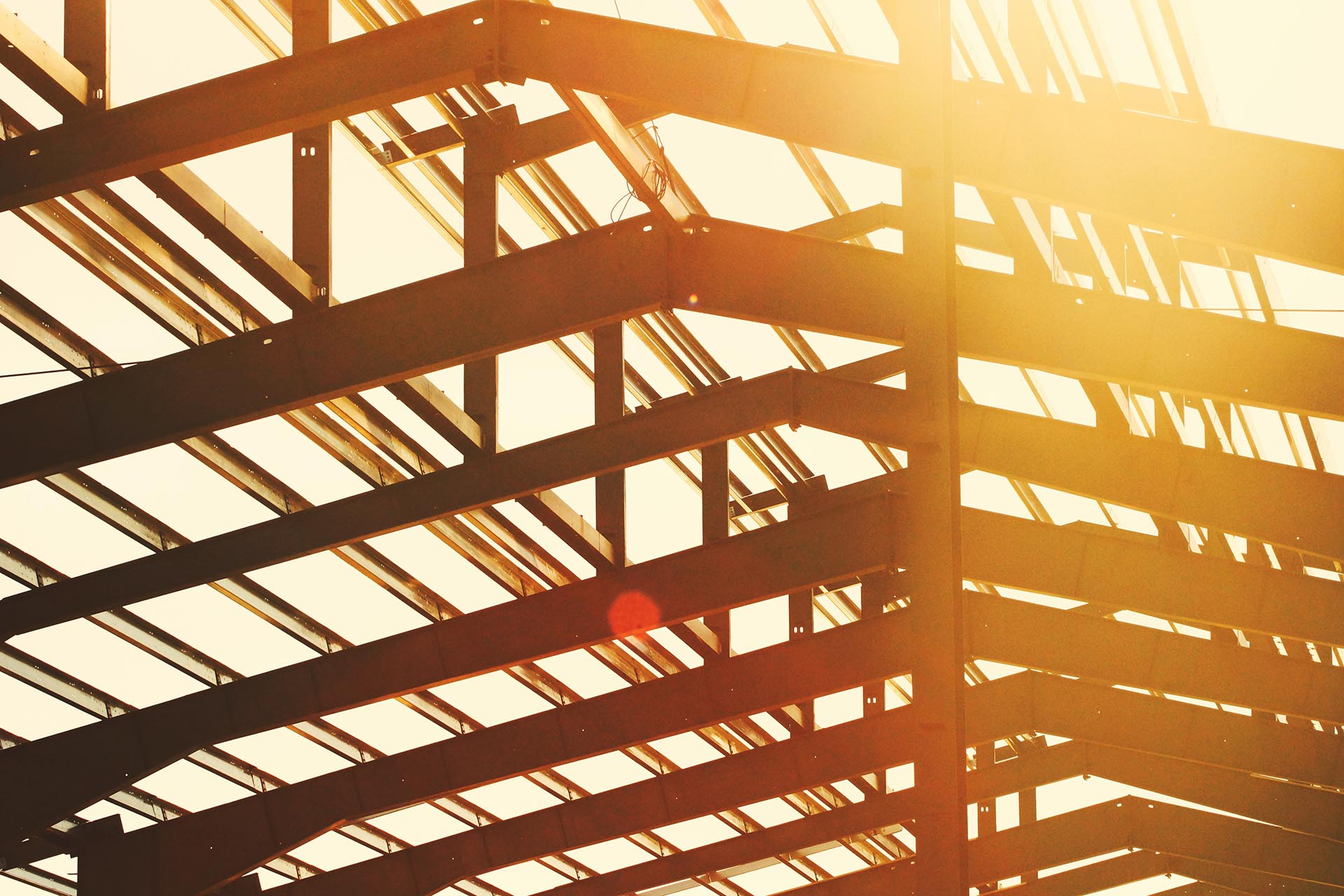 Exposed trusses with sun shining through